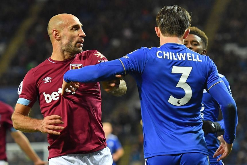 West Ham's Pablo Zabaleta (left) and Leicester's Ben Chilwell clash during the match.