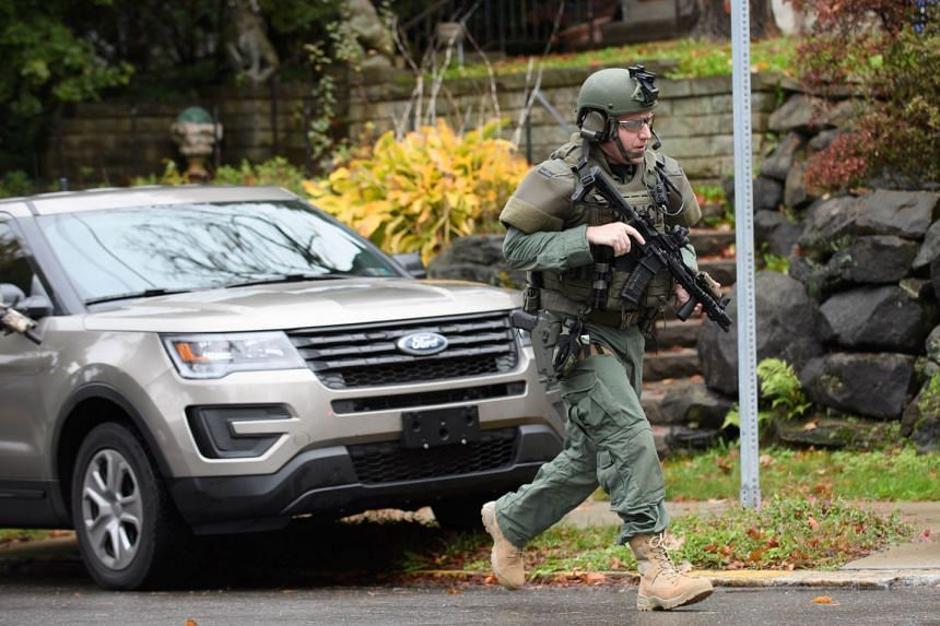 Police rapid response team members respond to the mass shooting.