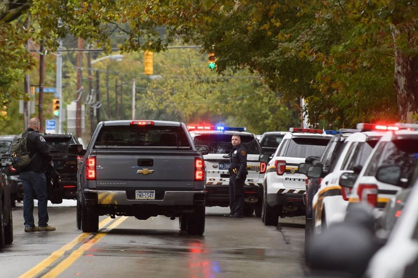 Police members respond to the mass shooting at the Tree of Life Synagogue.