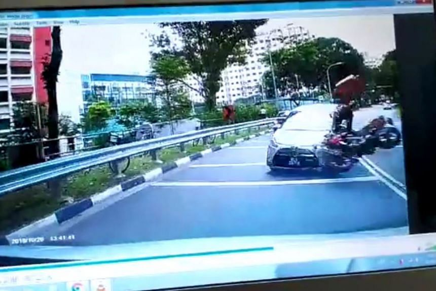 Four people, including a seven-year-old girl, were taken to hospital after an accident involving a car, a motorcycle and a van in Woodlands Ring Road on Oct 27, 2018.