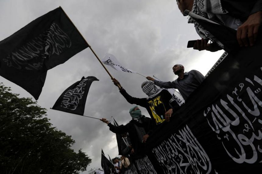 Activists holding a rally protesting the burning of a flag of hardline group Hizbut Tahrir Indonesia, in Banda Aceh, Indonesia, on Oct 25, 2018.