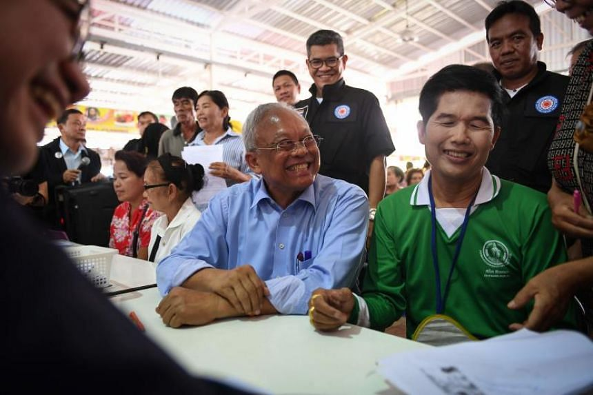 Thai politician Suthep Thaugsuban (centre) helping a supporter register as a member of his new Action Coalition for Thailand party on Oct 1, 2018.