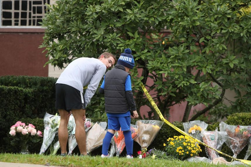 Children visit an impromptu memorial at the Tree of Life synagogue following the shooting in Pittsburgh, Pennsylvania, US, on Oct 28, 2018.