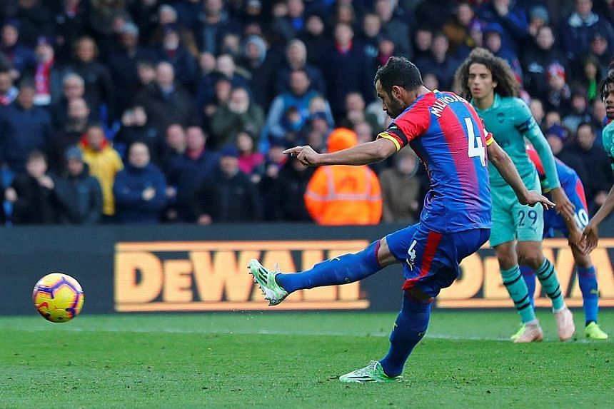 Crystal Palace's Luka Milivojevic scoring their late equaliser for his second spot-kick goal of the game. His opener in the first half was his team's first goal at Selhurst Park this season.