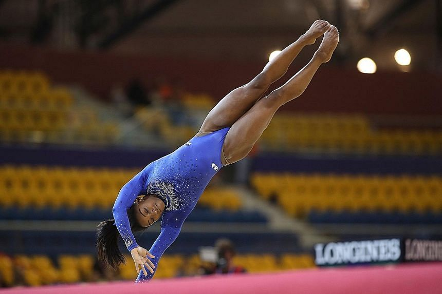 Simone Biles in the floor qualification on Saturday at the 48th Artistic Gymnastics World Championships at Aspire Dome in Doha. She will deal with her kidney stone problems only after the competition.
