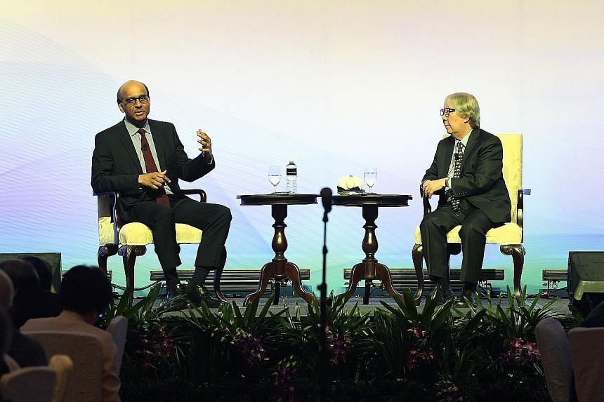 Deputy Prime Minister Tharman Shanmugaratnam and Professor Tommy Koh at the Marina Bay Sands convention centre last Thursday. They exchanged views on matters including sustaining social mobility and reducing poverty in Singapore.