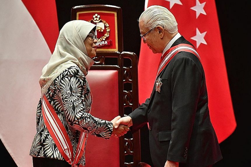 """Dr Tony Tan Keng Yam, former president, receiving the Order of Temasek (First Class) award, the nation's highest civilian honour, from President Halimah Yacob yesterday. Mr Hsieh Fu Hua received a Meritorious Service Medal for being """"a strong advocat"""