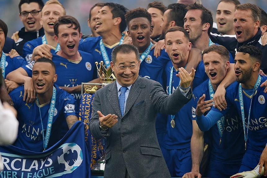 Leicester City's owner Vichai Srivaddhanaprabha with the team at the King Power Stadium when they won the English Premier League in 2016. It was the first top-flight title in the club's history. Left: Flames engulf the helicopter believed to have bee