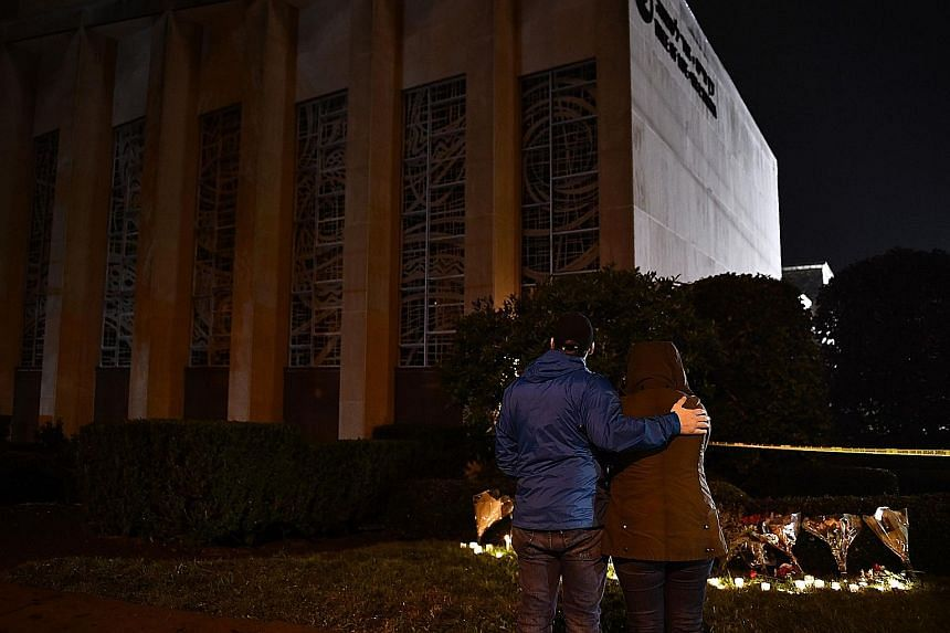 """Crowds at an interfaith vigil at the Sixth Presbyterian Church after a mass shooting at the nearby Tree of Life synagogue left 11 dead in Pittsburgh, Pennsylvania, on Saturday. Robert Bowers had reportedly walked into the building and yelled """"all Jew"""