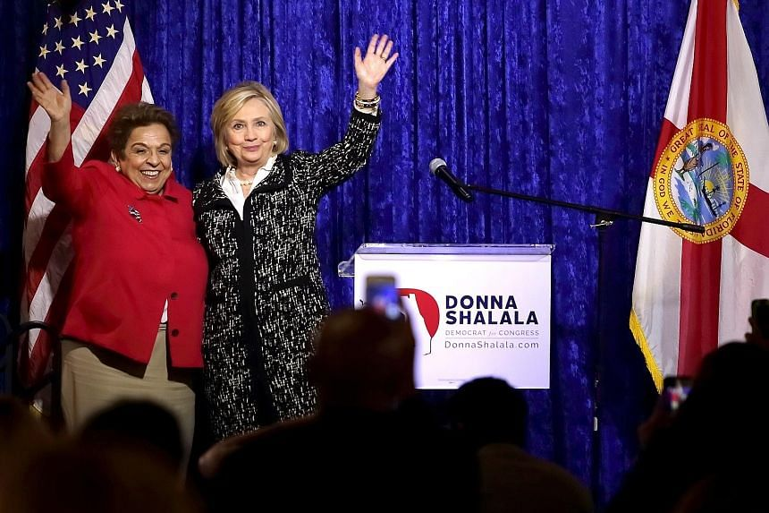 Democratic Party politician Donna Shalala (left) with former secretary of state Hillary Clinton at a lunch reception held as part of Ms Shalala's congressional campaign in Miami last Wednesday. Ms Shalala has described the Nov 6 midterm elections, se