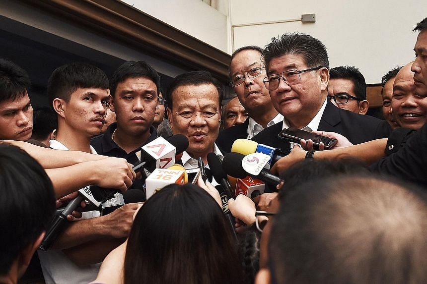 PUEA THAI Retired policeman Viroj Pao-In (centre) speaking to journalists after being named the leader of the party yesterday. ACTION COALITION FOR THAILAND Former deputy prime minister Suthep Thaugsuban (in blue shirt) helping a supporter register a