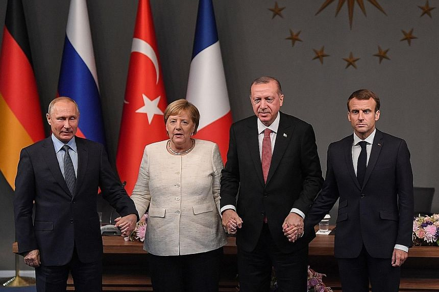 (From left) Russian President Vladimir Putin, German Chancellor Angela Merkel, Turkish President Recep Tayyip Erdogan and French President Emmanuel Macron after the summit in Istanbul last Saturday.