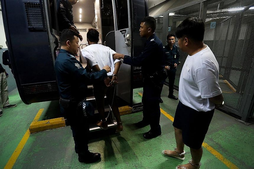 Convicts are then escorted into a Black Maria, or a prison transport bus, that will take them to the prison in Changi.