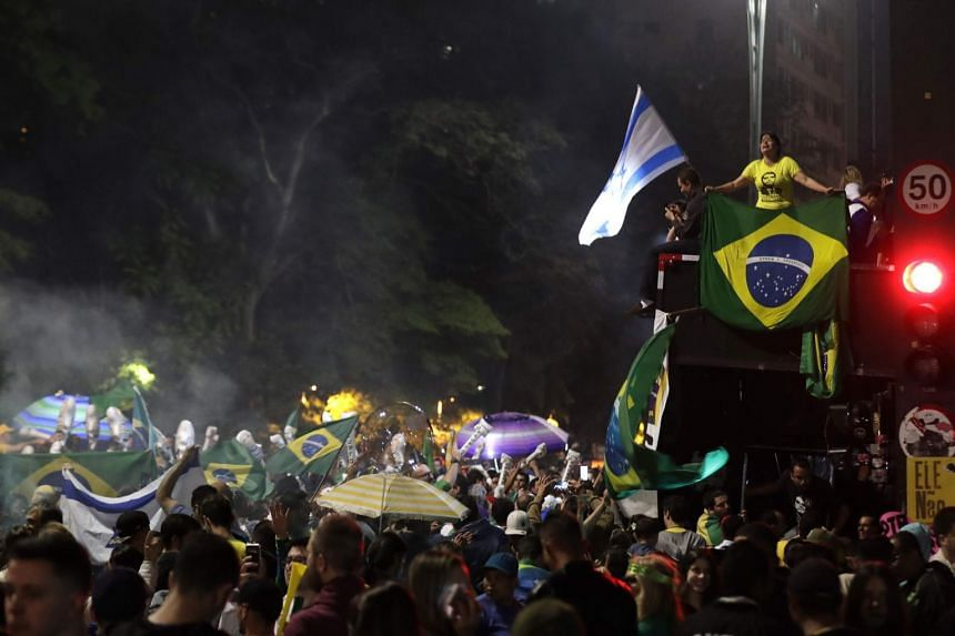 Supporters of Brazilian far-right presidential candidate Jair Bolsonaro celebrate his victory at the Paulista Avenue, in Sao Paulo, Brazil, on Oct 28, 2018.