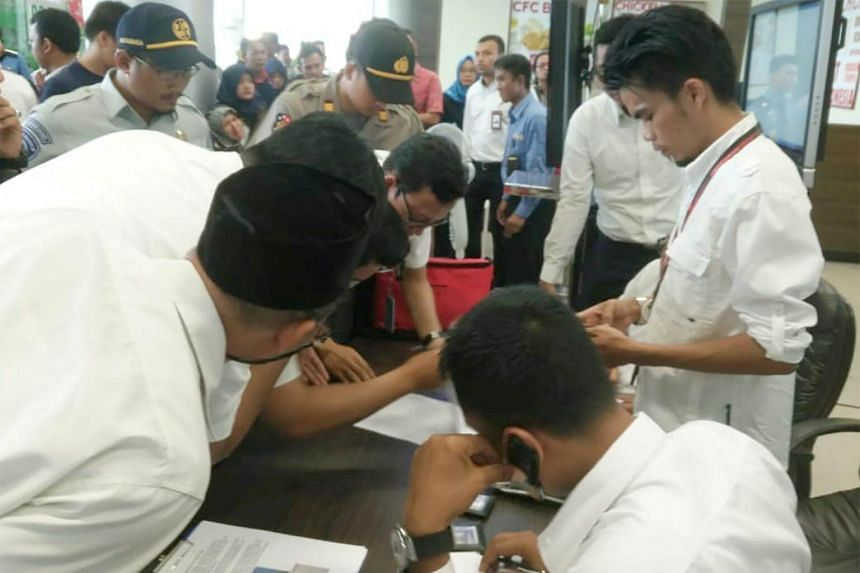 Lion Air officials checking the passenger list of Lion Air flight JT 610 that crashed into the sea, at Depati Amir airport in Pangkal Pinang, Indonesia, on Oct 29, 2018.