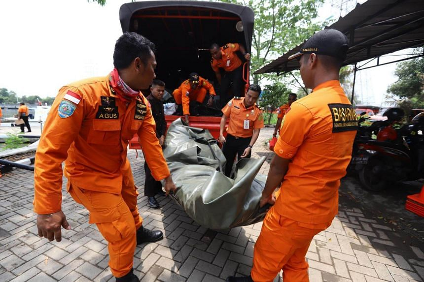 Members of a rescue team prepare to search for survivors from the Lion Air flight JT 610, which crashed into the sea, at Jakarta seaport, on Oct 29, 2018.