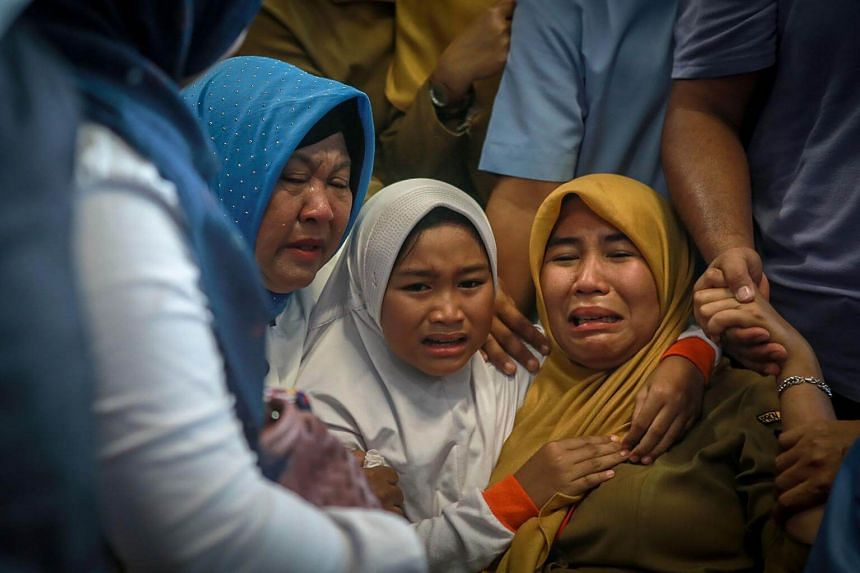 Family members of passengers on the crashed Indonesian Lion Air JT 610 at Pangkal Pinang airport, in Bangka Belitung province, on Oct 29, 2018.