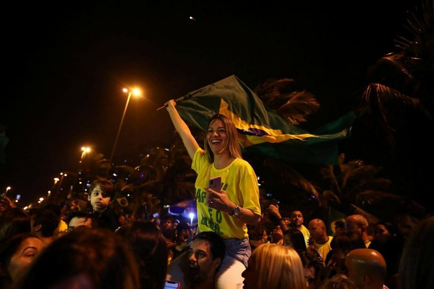 Supporters of Jair Bolsonaro celebrate after polls closed, in Rio de Janeiro, Brazil, on Oct 28, 2018.