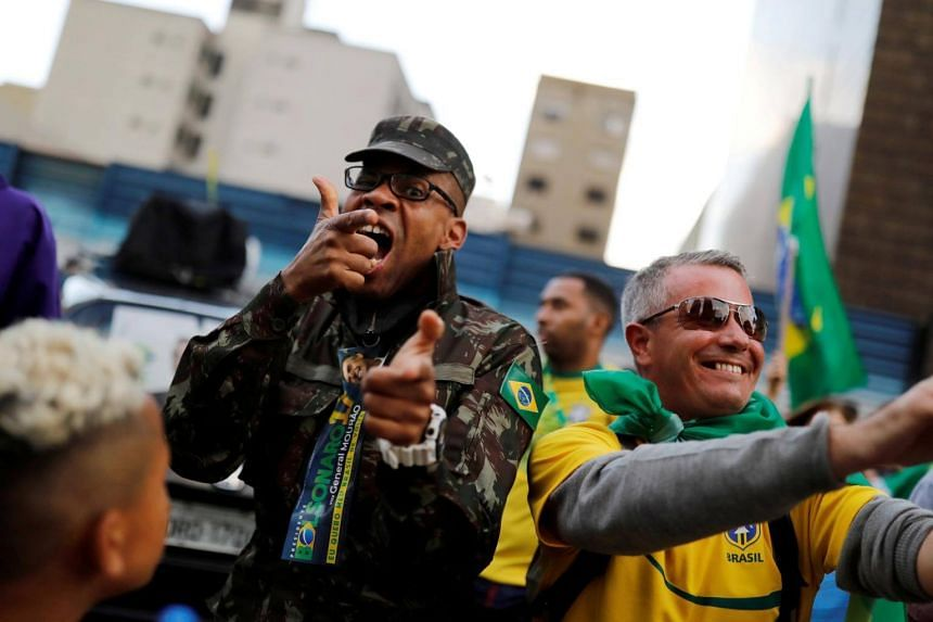 Supporters of Jair Bolsonaro reacting during a run-off election in Sao Paulo, Brazil, on Oct 28, 2018.