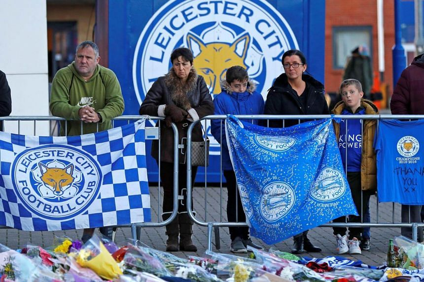 Leicester City football fans pay their respects outside the football stadium, after the helicopter of club owner Vichai Srivaddhanaprabha crashed when leaving the ground after the match, on Oct 28, 2018.