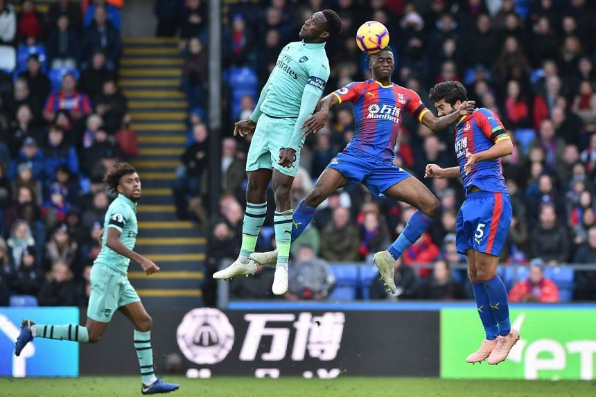 (From left) Arsenal striker Danny Welbeck, Crystal Palace midfielder Aaron Wan-Bissaka and Palace defender James Tomkins go up for a header during their English Premier League football match at Selhurst Park on Oct 28, 2018.