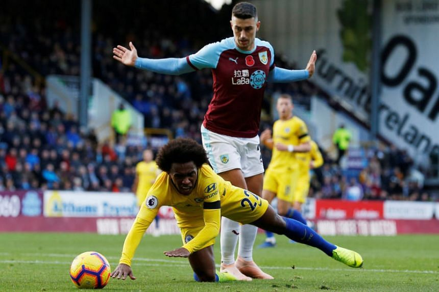 Chelsea's Willian in action with Burnley's Matthew Lowton at the Turf Moor, Burnley, Britain, on Oct 28, 2018.