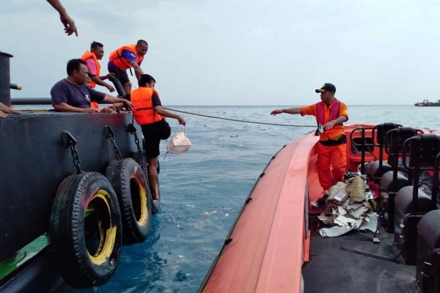 Indonesian rescuers retrieving parts from the crashed Lion Air plane in waters off Tanjung Karawang, West Java, Indonesia.