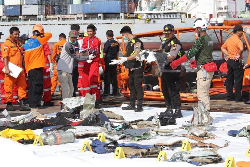 Indonesian rescue team members collecting items recovered from the crashed Lion Air flight JT610 at Tanjung Priok Harbour in Indonesia.