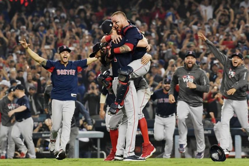 Christian Vazquez hugs fellow Boston Red Sox teammate Chris Sale to celebrate their victory over the Los Angeles Dodgers to win the 2018 World Series in Los Angeles on Oct 28, 2018.