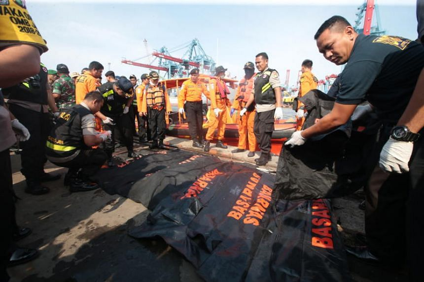 Indonesian rescue team members evacuate the bodies of the victims of the crashed Lion Air flight JT610 at Tanjung Priok Harbour, Indonesia, on Oct 29, 2018.
