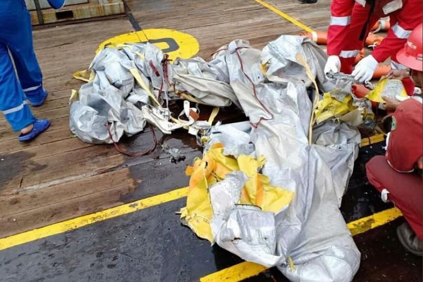 Items believed to be from the wreckage of the Lion Air flight JT610, recovered off the coast of Indonesia's Java island after the Boeing crashed into the sea.