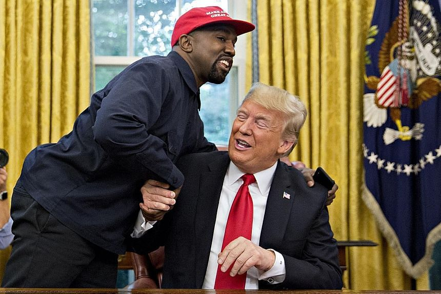 Rapper Kanye West (far left), a staunch supporter of United States President Donald Trump, meeting the latter in the Oval Office earlier this month.