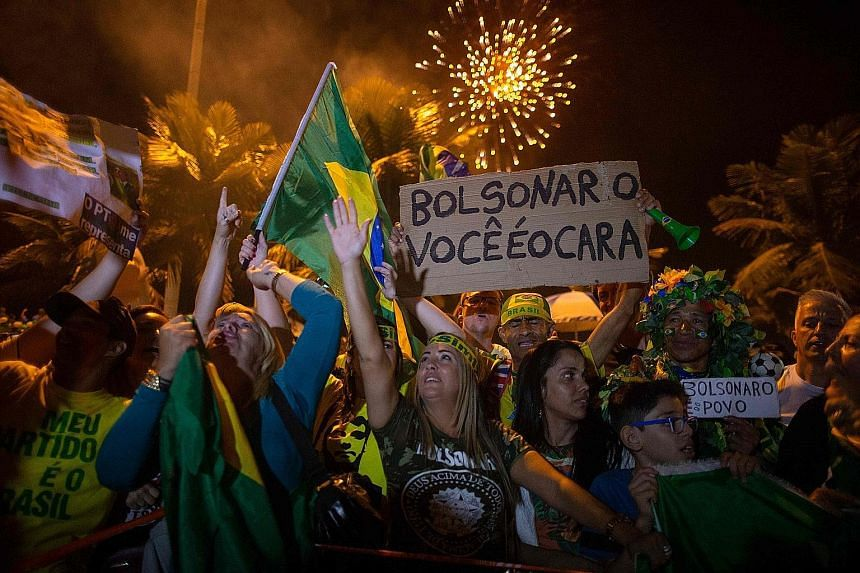 Mr Jair Bolsonaro's supporters cheering after his victory was announced on Sunday. The 63-year-old won a convincing 55.1 per cent of votes in the run-off election. Mr Jair Bolsonaro, a former army captain, has promised to gut endemic political corrup