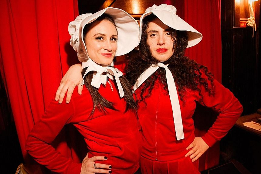 Handmaid's Tale: The Musical's co-creators Melissa Stokoski (far left) and Marcia Belsky play the central characters of Rory Gilmore and Offred in the dystopian parody.