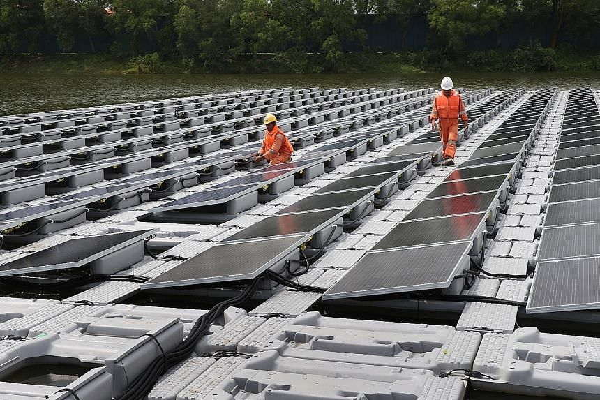 Singapore's solar panel test bed at Tengeh Reservoir in Tuas. Asean's memorandum of understanding with the International Renewable Energy Agency will see both organisations meeting regularly to achieve the goal of almost doubling the bloc's share of