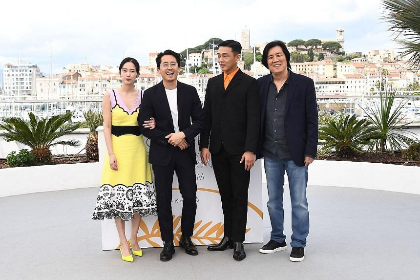 (From far left) South Korean actress Jun Jong-seo, US-South Korean actor Steven Yeun, South Korean actor Yoo Ah-in and South Korean director Lee Chang-dong at a photocall for the film, Burning, at the Cannes Film Festival in May.