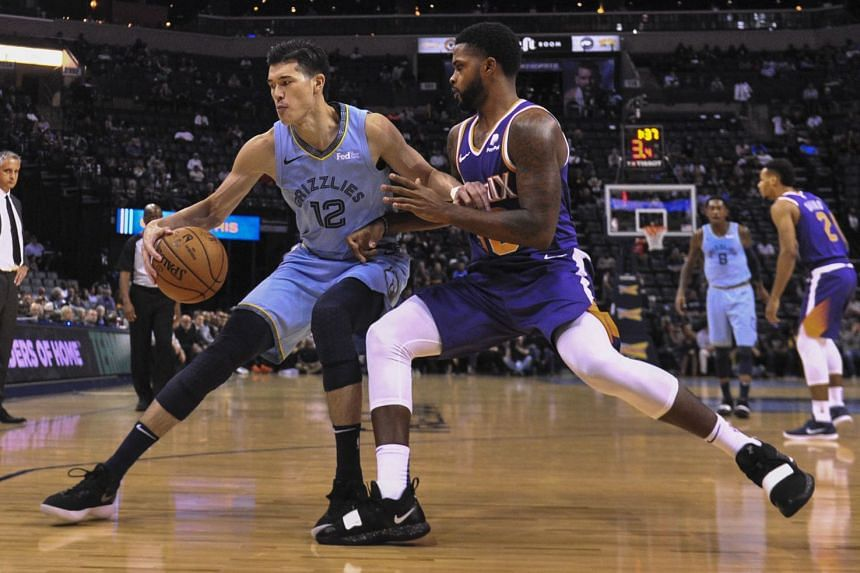 Memphis Grizzlies forward Yuta Watanabe goes to the basket against Phoenix Suns guard Troy Daniels at the FedExForum, in Memphis on Oct 28, 2018.
