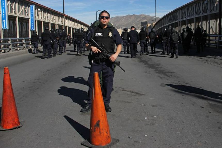 US Customs and border patrol agents take part in a border security drill at the US-Mexico international bridge, as seen from Ciudad Juarez, Mexico, on Monday (Oct 29, 2018).