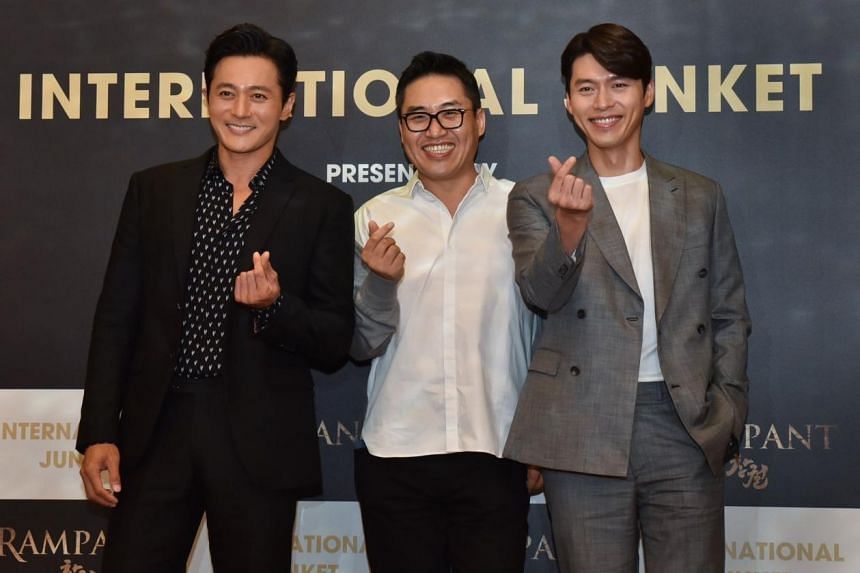 (From left) Actor Jang Dong-gun, director Kim Sung-hoon and actor Hyun Bin at the release of period zombie movie Rampant, which opens on Nov 1, 2018.