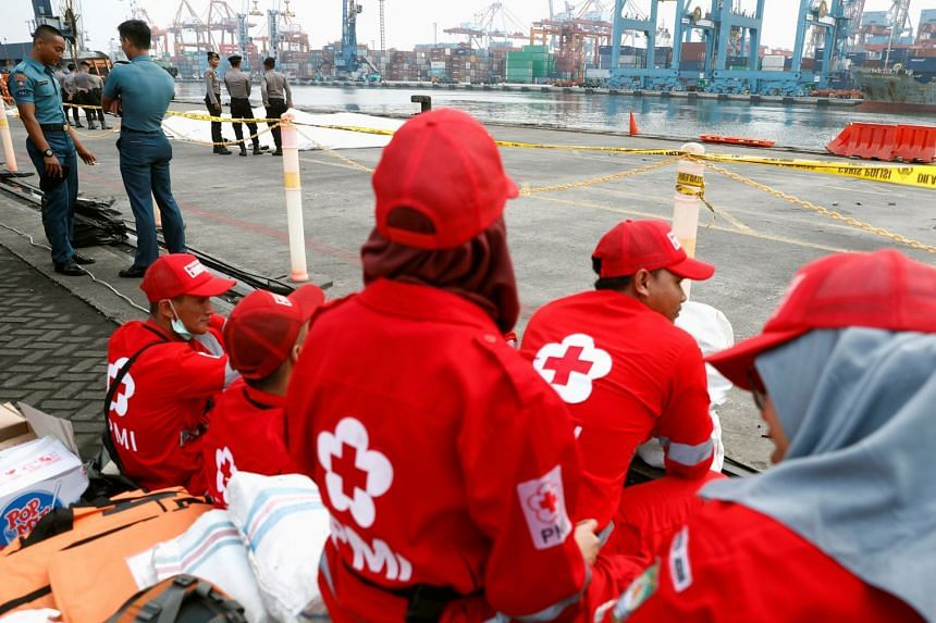 Indonesian rescue team members wait for bodies of those who perished in the Lion Air flight JT610 crash at Tanjung Priok port in Jakarta, on Oct 30, 2018.