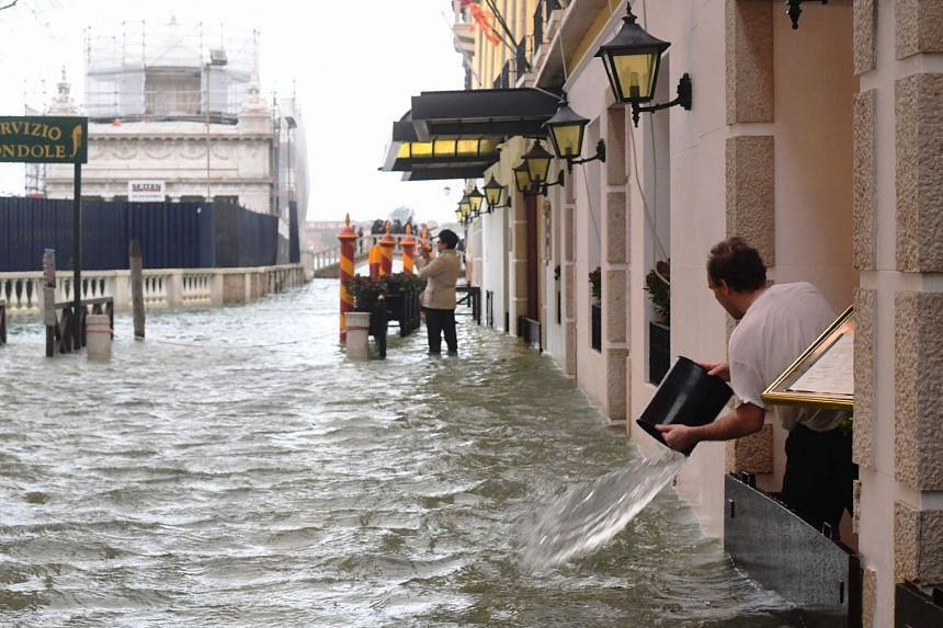 Tourists walk in the flooded streets during a high-water (Acqua Alta) alert in Venice, Italy, on Oct 29, 2018.