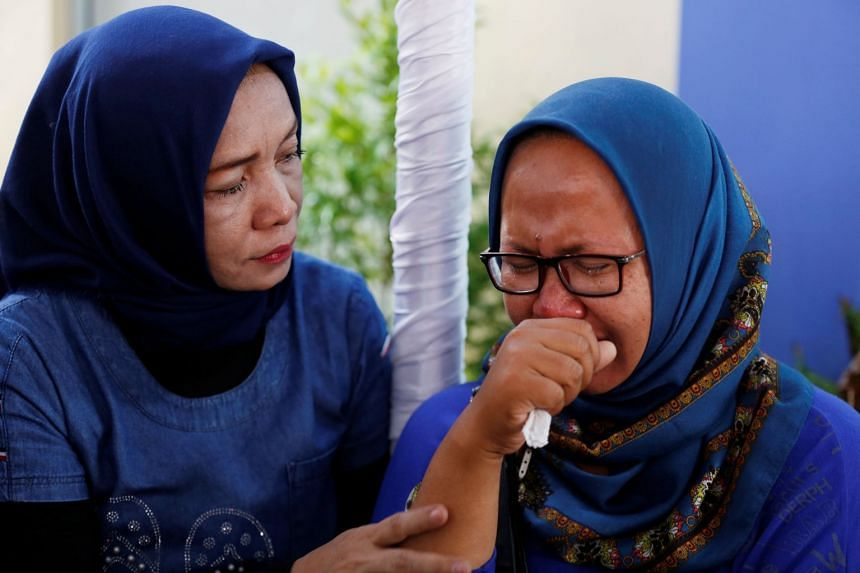 Relatives of passengers on the crashed Lion Air flight JT610, cry at Bhayangkara R. Said Sukanto hospital in Jakarta, on Oct 30, 2018.