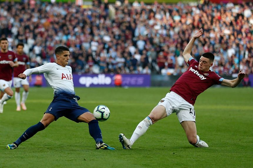 Tottenham Hotspur's Argentinian midfielder Erik Lamela (left) vies with West Ham United's Irish defender Declan Rice during the English Premier League football match between West Ham United and Tottenham Hotspur at the London Stadium, in east London,