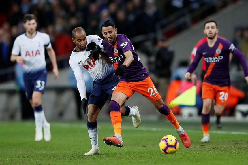 Manchester City's Riyad Mahrez in action with Tottenham's Lucas Moura in Wembley Stadium, London, Britain, on Oct 29, 2018.