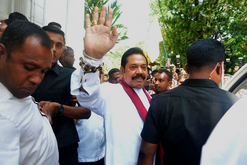 Former strongman Mahinda Rajapaksa (pictured) gave four legislators from rival Ranil Wickremesinghe's party ministerial portfolios after persuading them to defect on Oct 29, 2018.