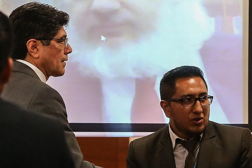 Foreign Minister of Ecuador, Jose Valencia (left), speaks with participants in a hearing where founder of WikiLeaks, JulianAssange, participate through teleconference in Quito, Ecuador, on Oct 29, 2018.