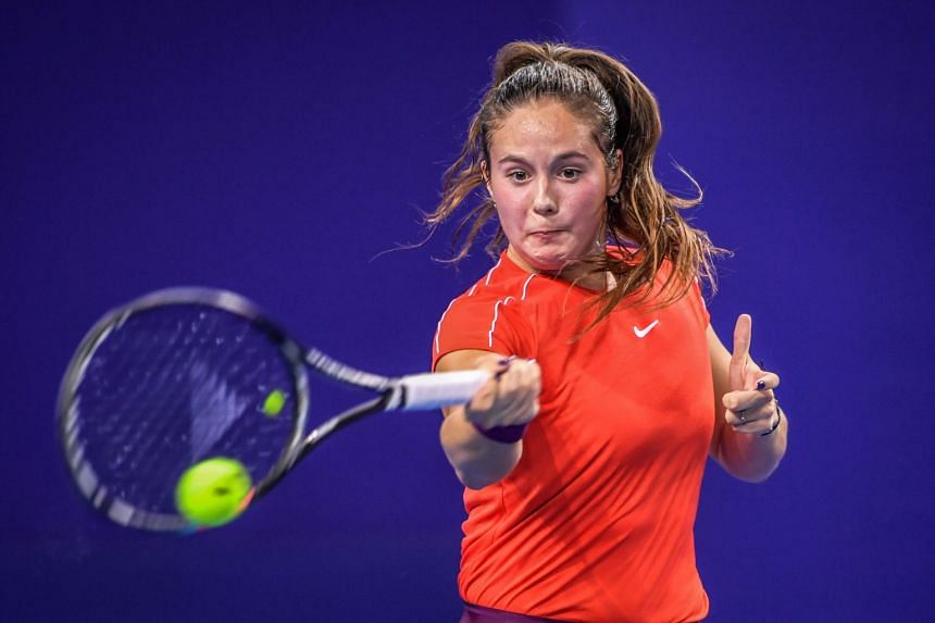 Kasatkina hits a return against Wang Qiang of China in their first-round match of the Zhuhai Elite Trophy tournament,