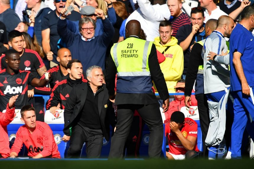 Mourinho (centre, left) reacting to Ianni (far right, in pale blue) after Chelsea's second goal.