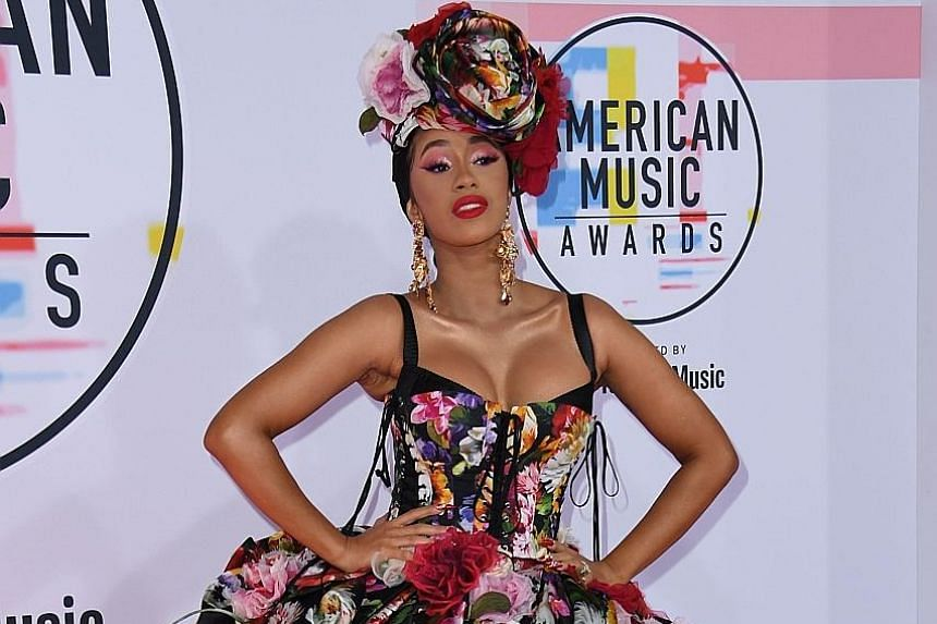 Rappers Cardi B (left) at the American Music Awards in Los Angeles earlier this month and Nicki Minaj (right) during Milan Fashion Week last month. Minaj has said they should both take lie-detector tests to find out who is speaking the truth in their