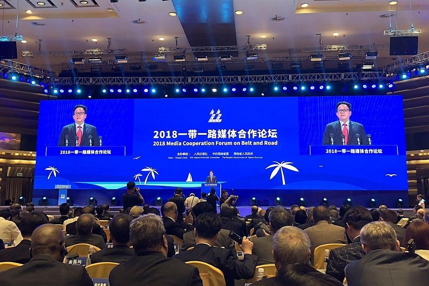 Singapore Press Holdings chief executive officer Ng Yat Chung delivering a speech at the Belt and Road forum on media cooperation at Boao in Hainan province yesterday. He suggested that Beijing consider fine-tuning commercial and financial sustainabi